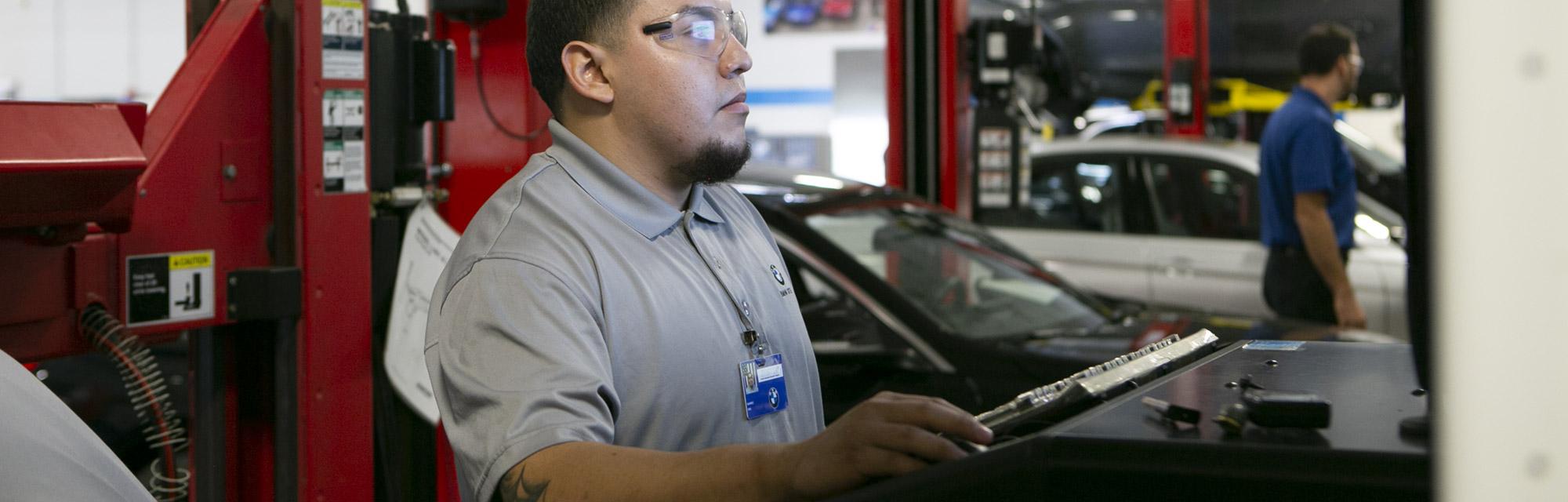 Auto Mechanic Student Monitoring Car Diagnostics