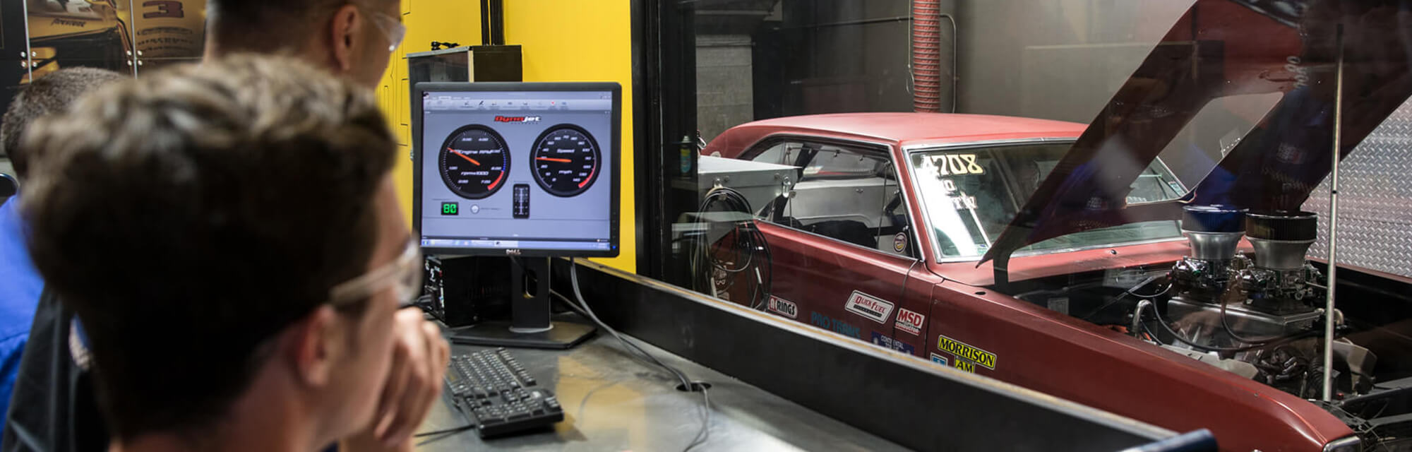 Auto Mechanic Students Tuning a Performance Engine
