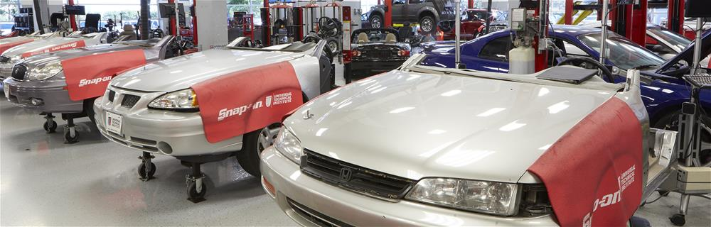Automobiles being repaired at the UTI labs