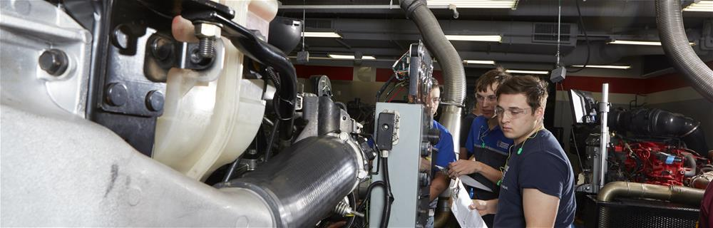 Student learning to inspect a diesel engine