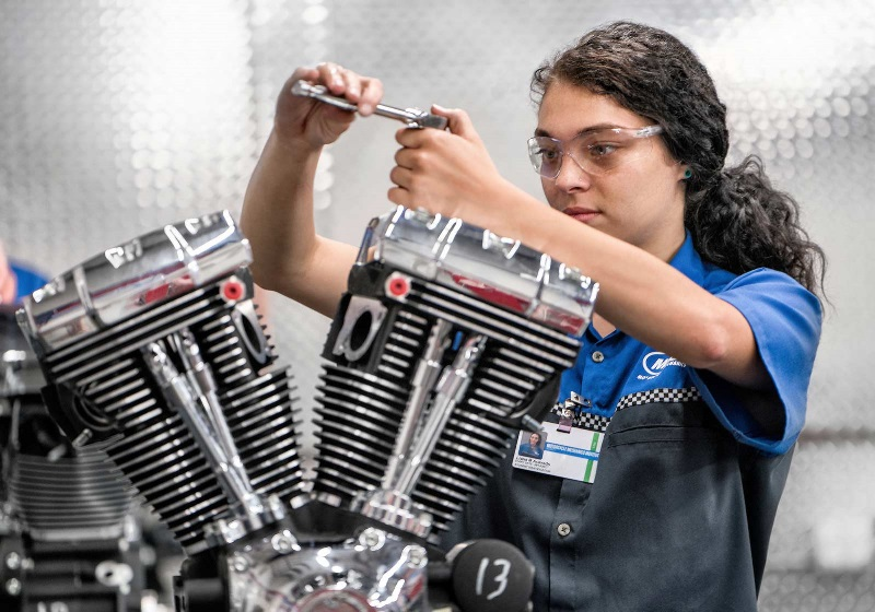 A student works on a Harley-Davidson® motorcycle engine in an MMI lab.