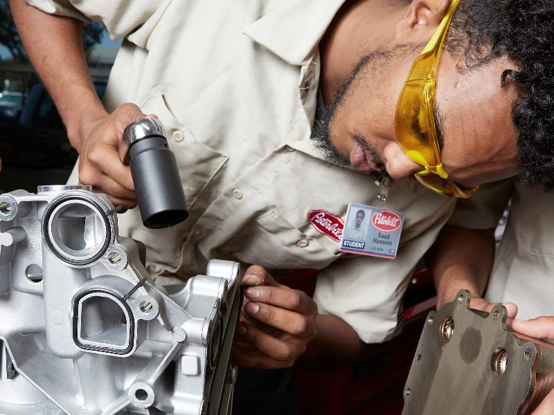 A diesel student works on an engine in a UTI lab.