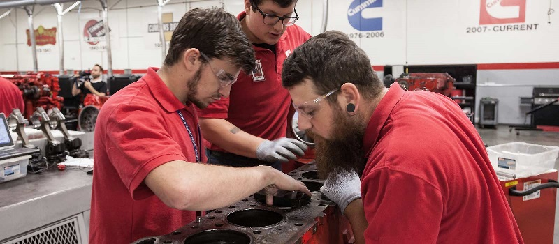 Students work on a diesel engine at one of UTI's labs.