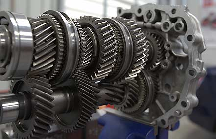 The transmission transfers the engine's power to the wheels.