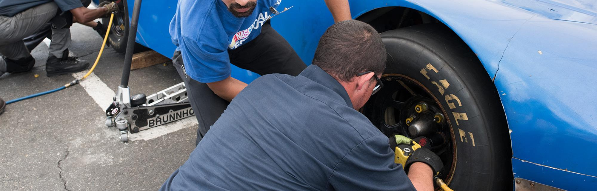 UTI students training to become a pit crew