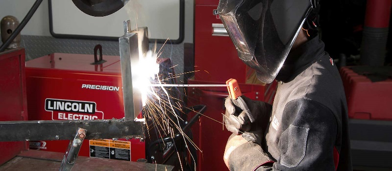 A student practices welding at a UTI lab.