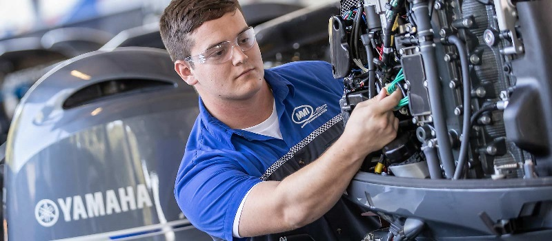 Student works on motor in lab at Marine Mechanics Institute.
