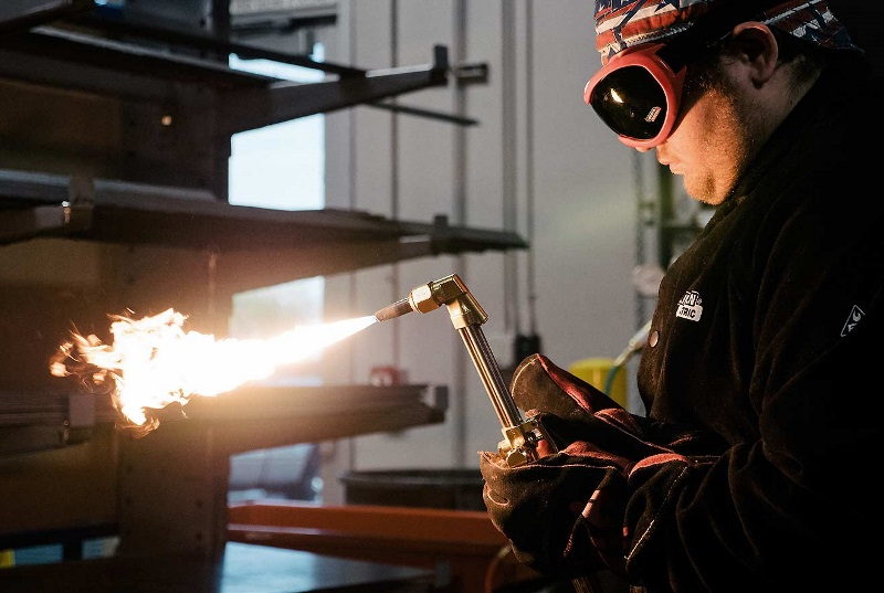 A student works on a weld at a UTI lab.