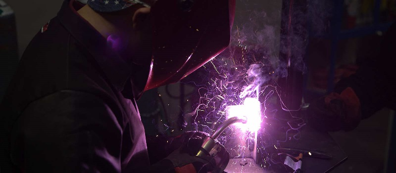 A welding student trains in one of UTI's labs