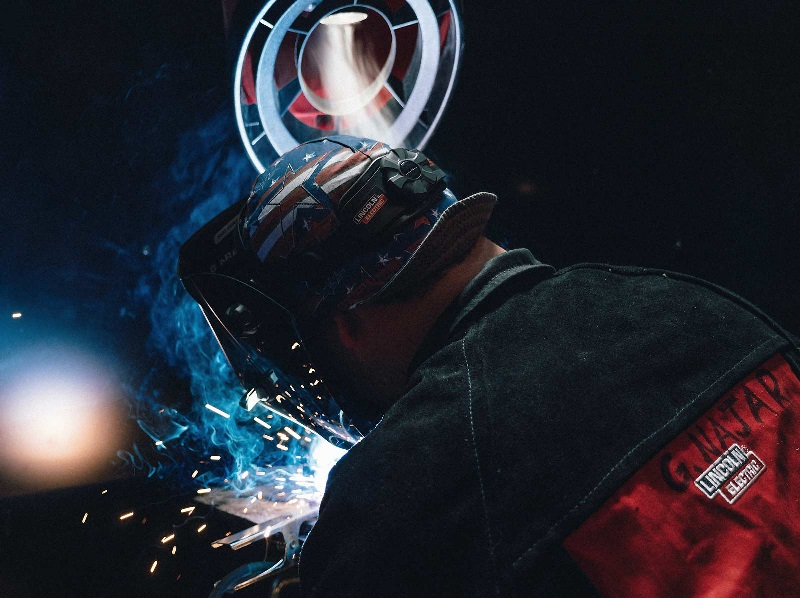 A welder works on a project.