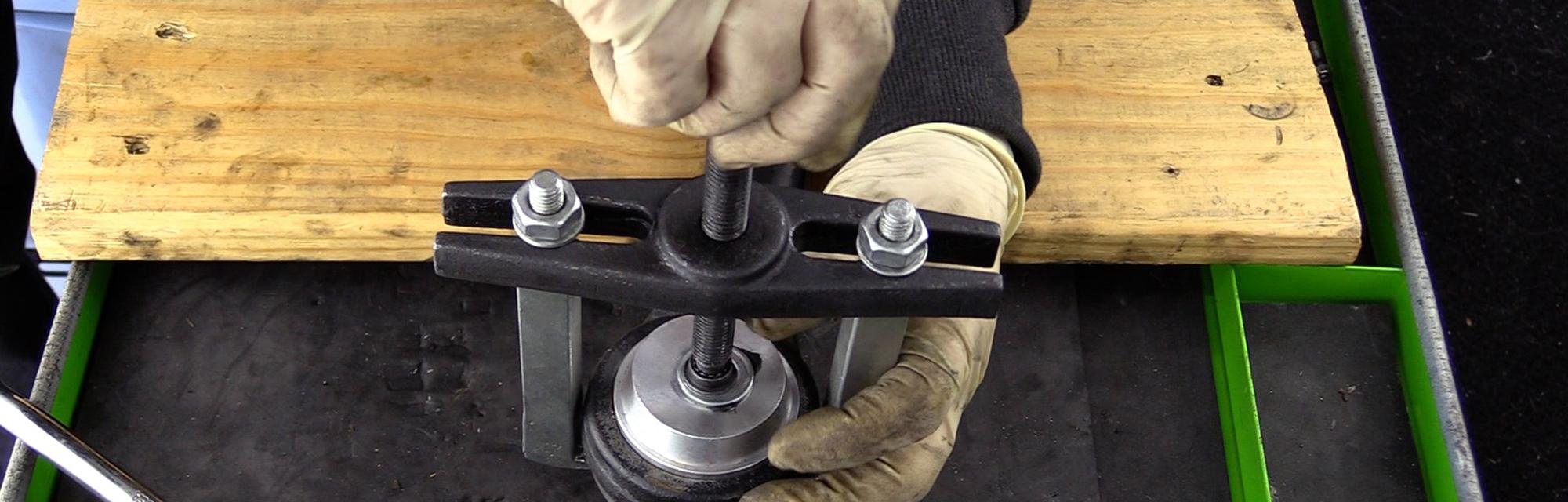 Mechanic inspecting a car part.