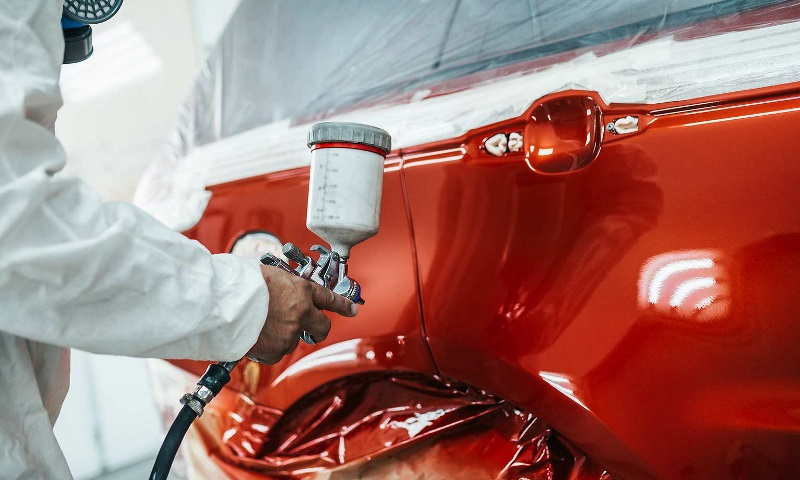 A coat of paint is applied to a vehicle.
