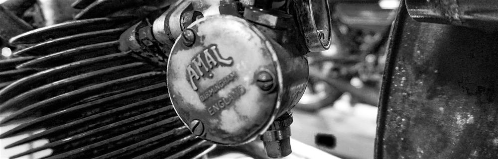 A closeup black and white photo of Amal from Birmingham, England, from the Motorcycle Mechanics Institute (MMI) Phoenix Vintage Café Racer class that is open to the public and MMI students alike.