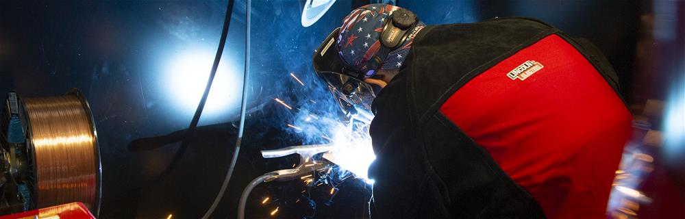 An image of someone welding for an article that is talking about the history of welding