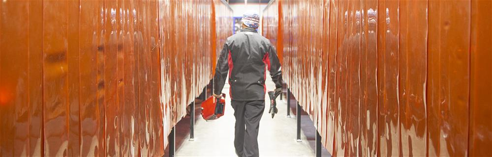 Man walking in locker room hallway