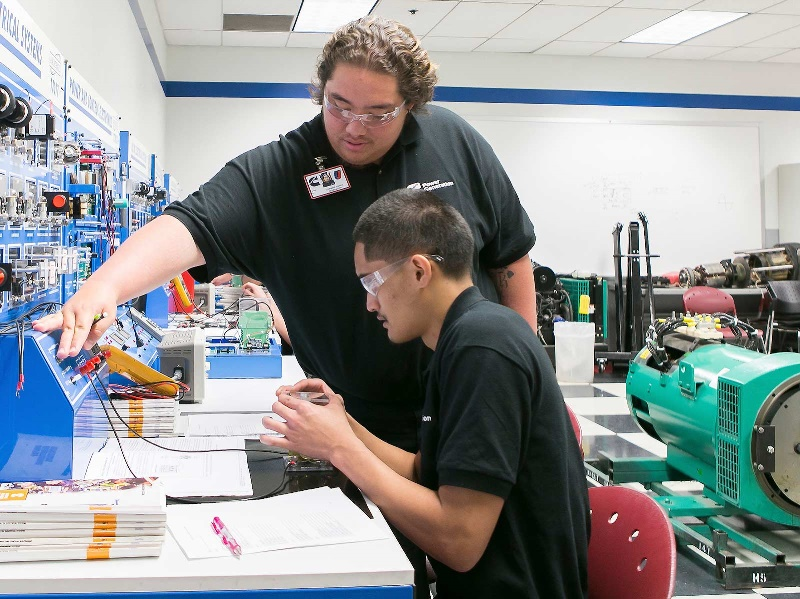 Diesel students work on a project in a UTI lab.