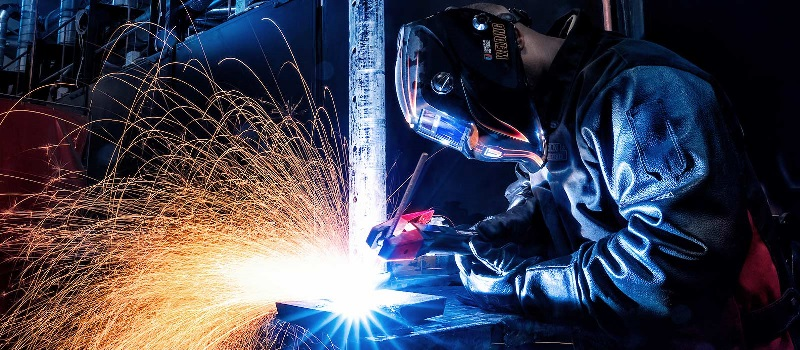 A welding student works in one of UTI's labs.