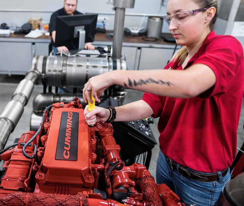 Diesel student works on an engine in a UTI lab.