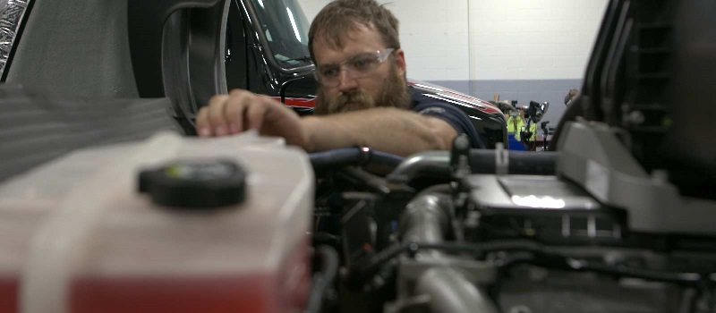 Student works on a diesel engine in one of UTI's labs.