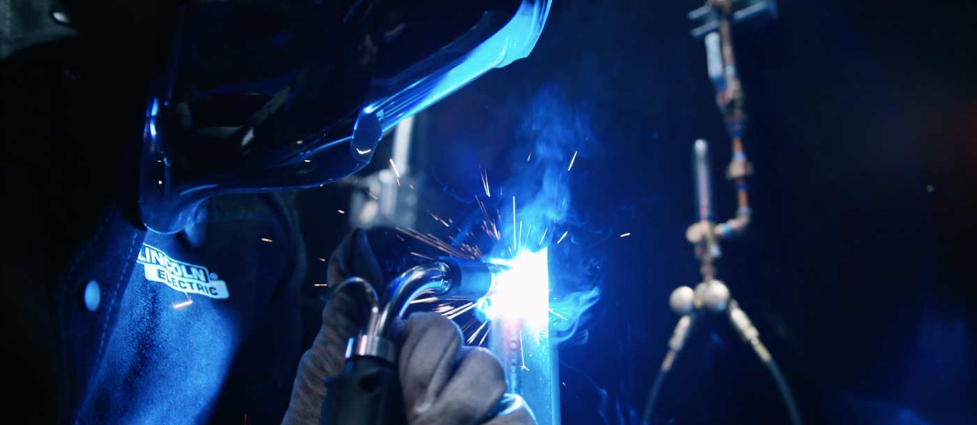 An image of someone at Universal Technical Institute MIG welding Gas Metal Arc Welding GMAW