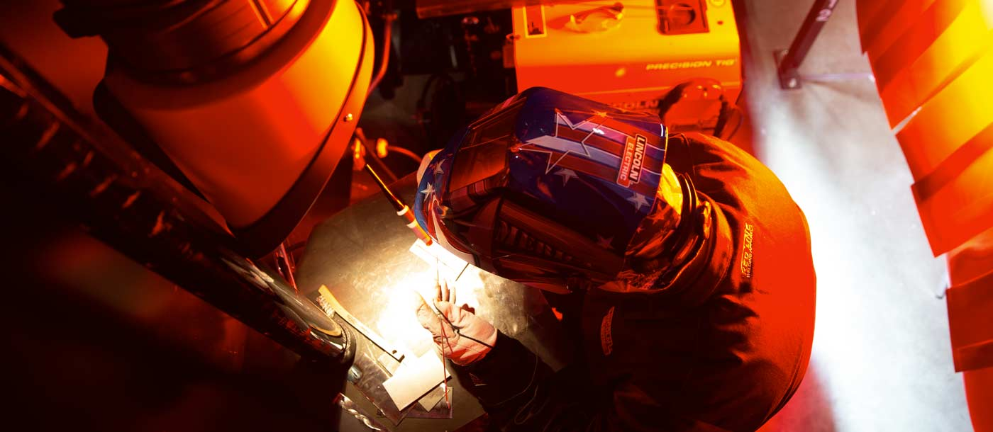 An image of an instructor at Universal Technical Institute TIG welding