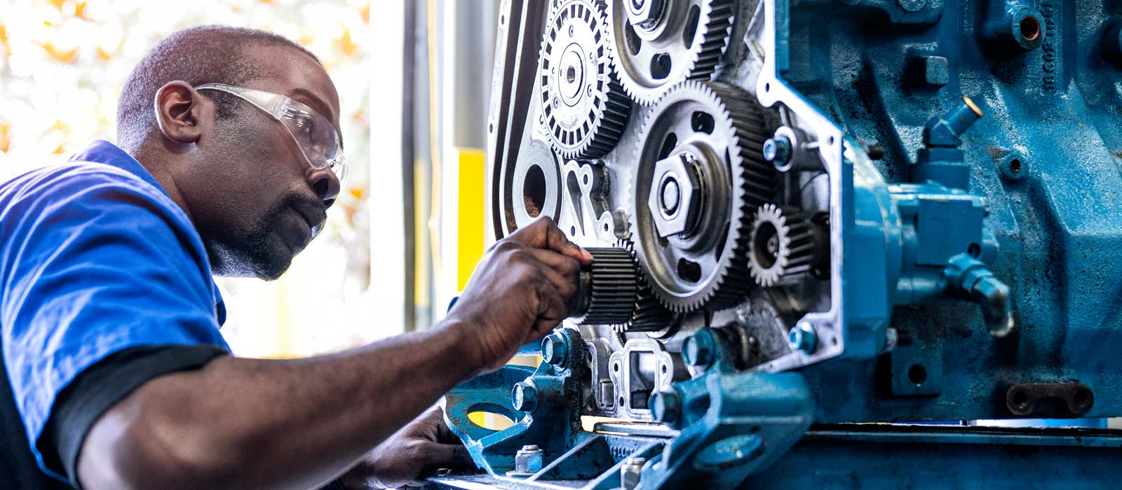 UTI diesel technician student working on an engine about diesel preventative maintenance
