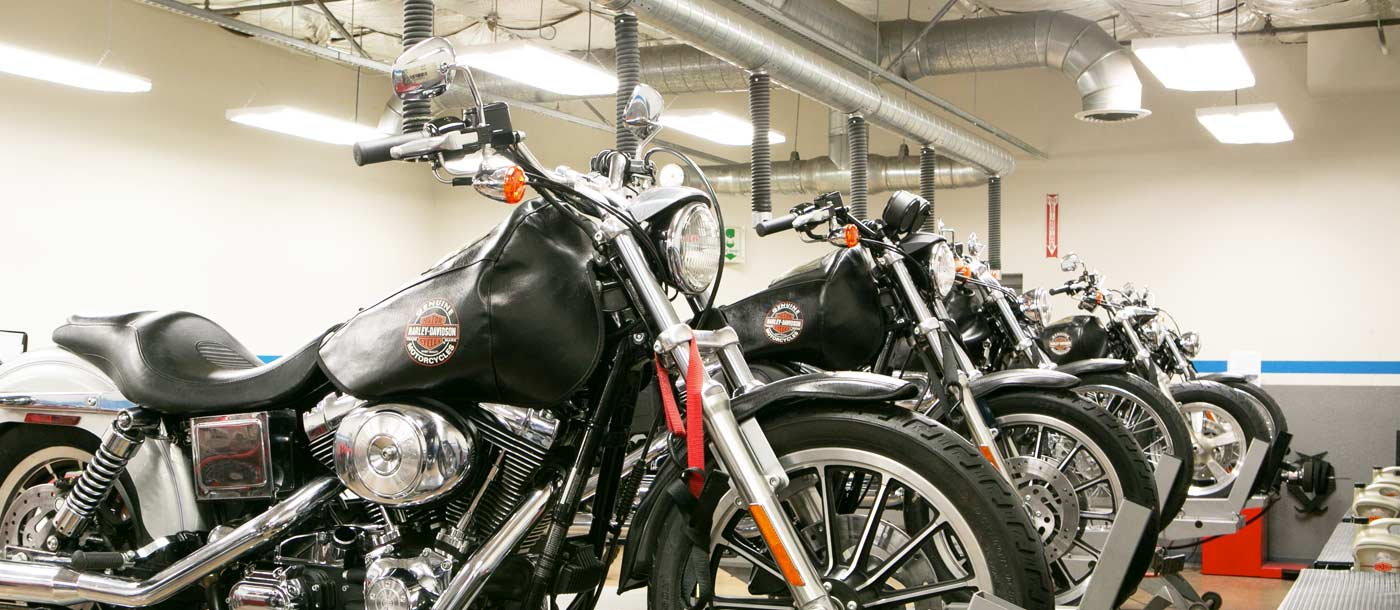 An image of Harley-Davidson motorcycles in a lab at Motorcycle Mechanics Institute in Phoenix, Arizona