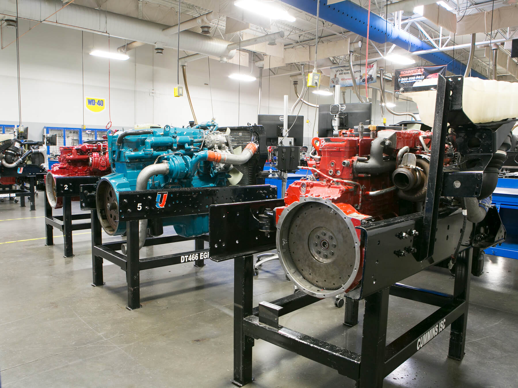 Blue and red Diesel engines in the diesel lab at Avondale Campus