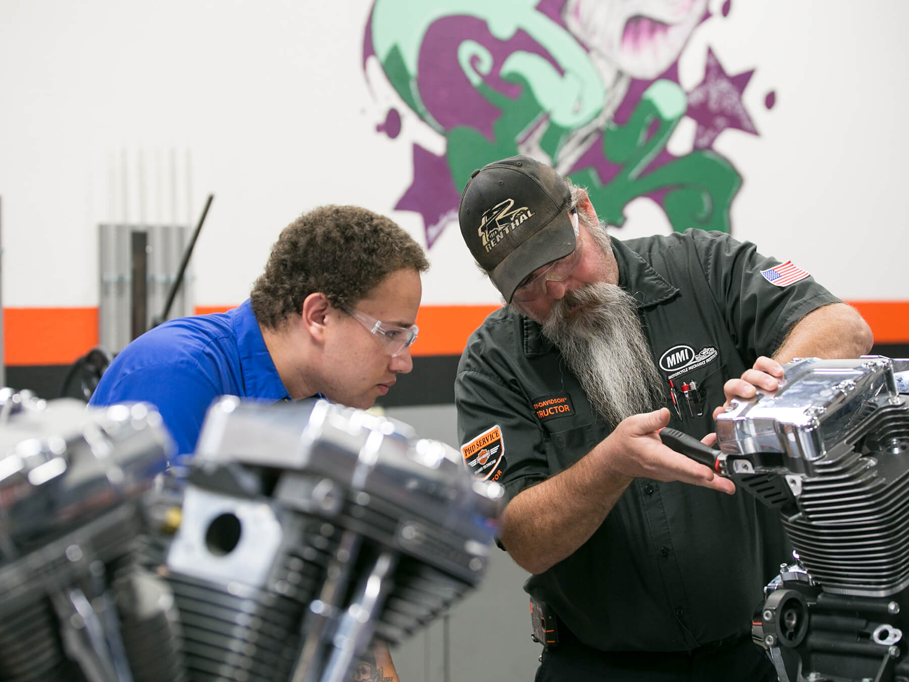 MMI. instructor showing a student an engine