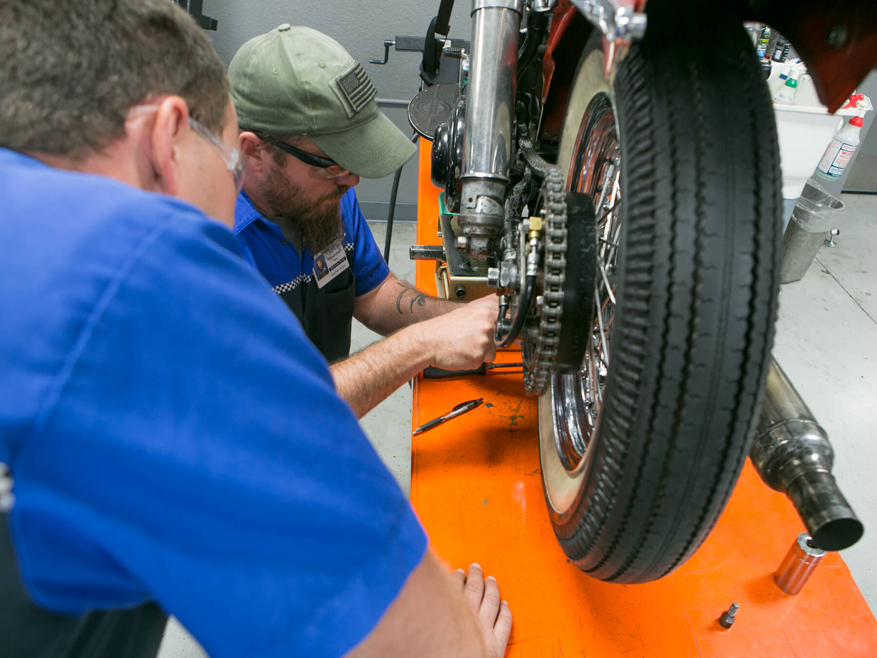 MMI students working on a motorcycle