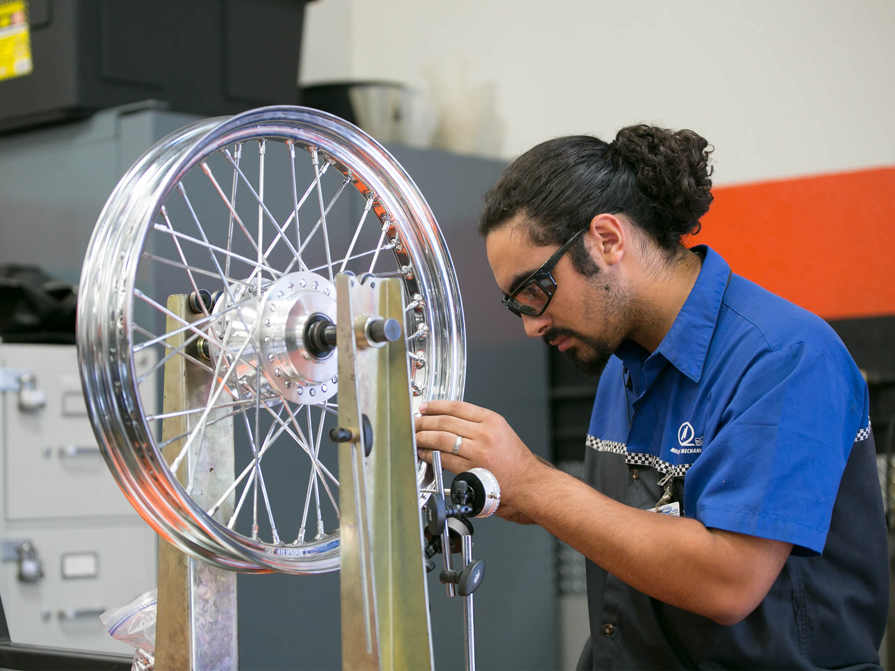 MMI student working on a tire rim