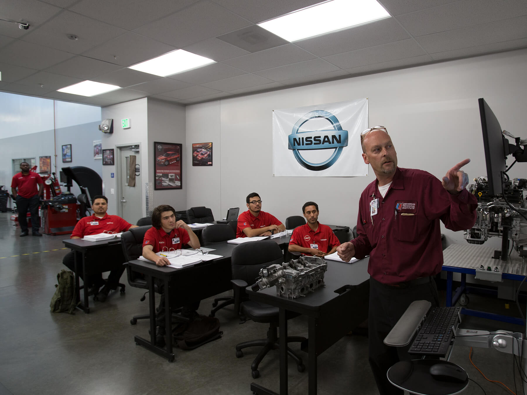 Front view photo of students looking at the instructor in the Nissan Class at Long Beach campus