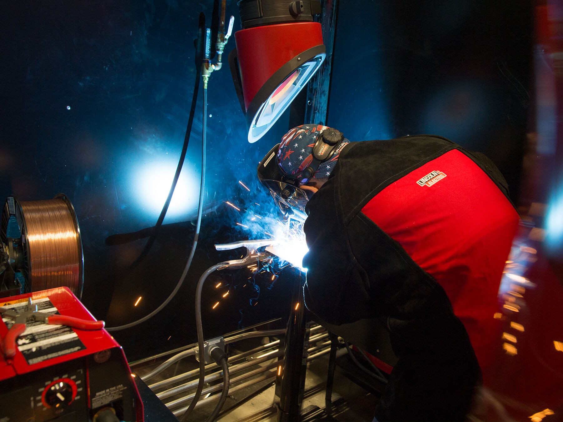 Back facing photo of UTI student welding