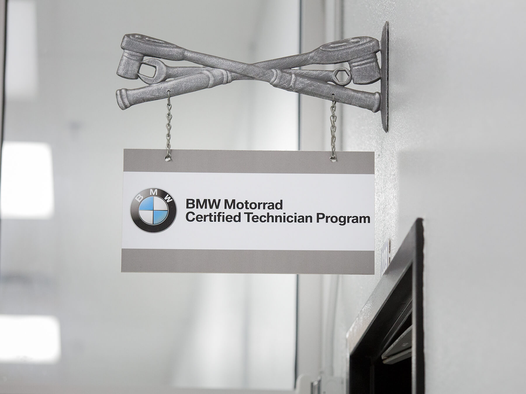 Close up on the BMW Motorad Program sign