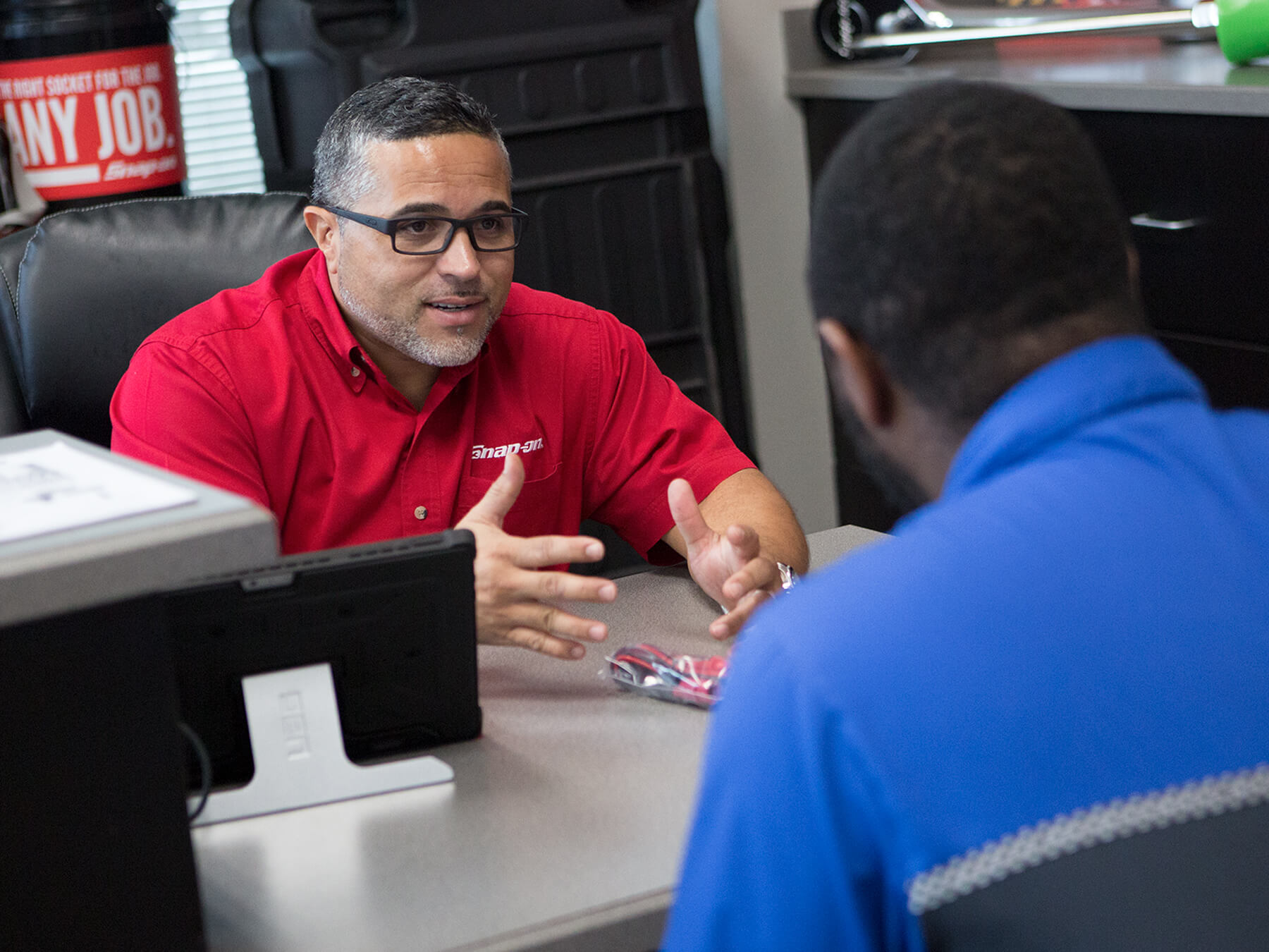 On campus Snap-On dealer talking to a UTI student
