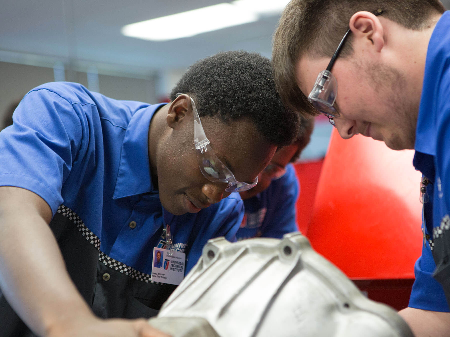 UTI students working on an engine