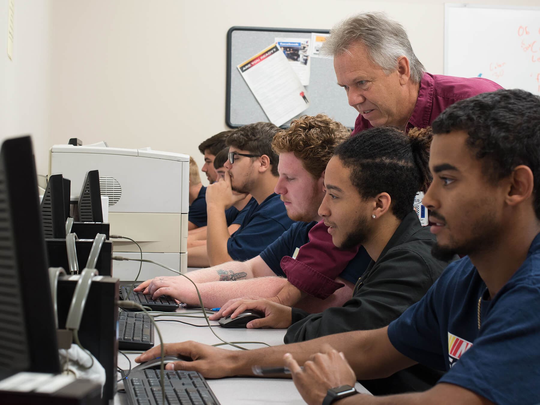 Instructor helping students in the LRC classroom at Mooresville campus