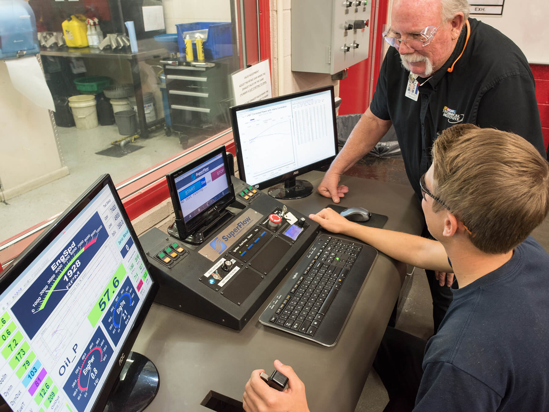 Instructor and student working in front of a computer in the DYNO lab at Mooresville campus