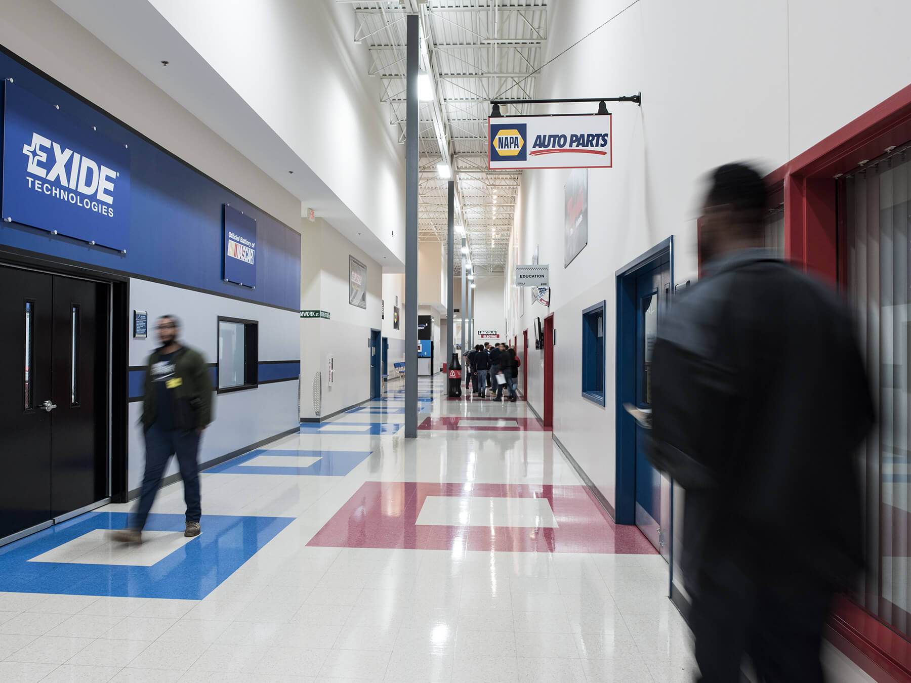 Photo of blurred students walking in the Hallway at Mooresville campus