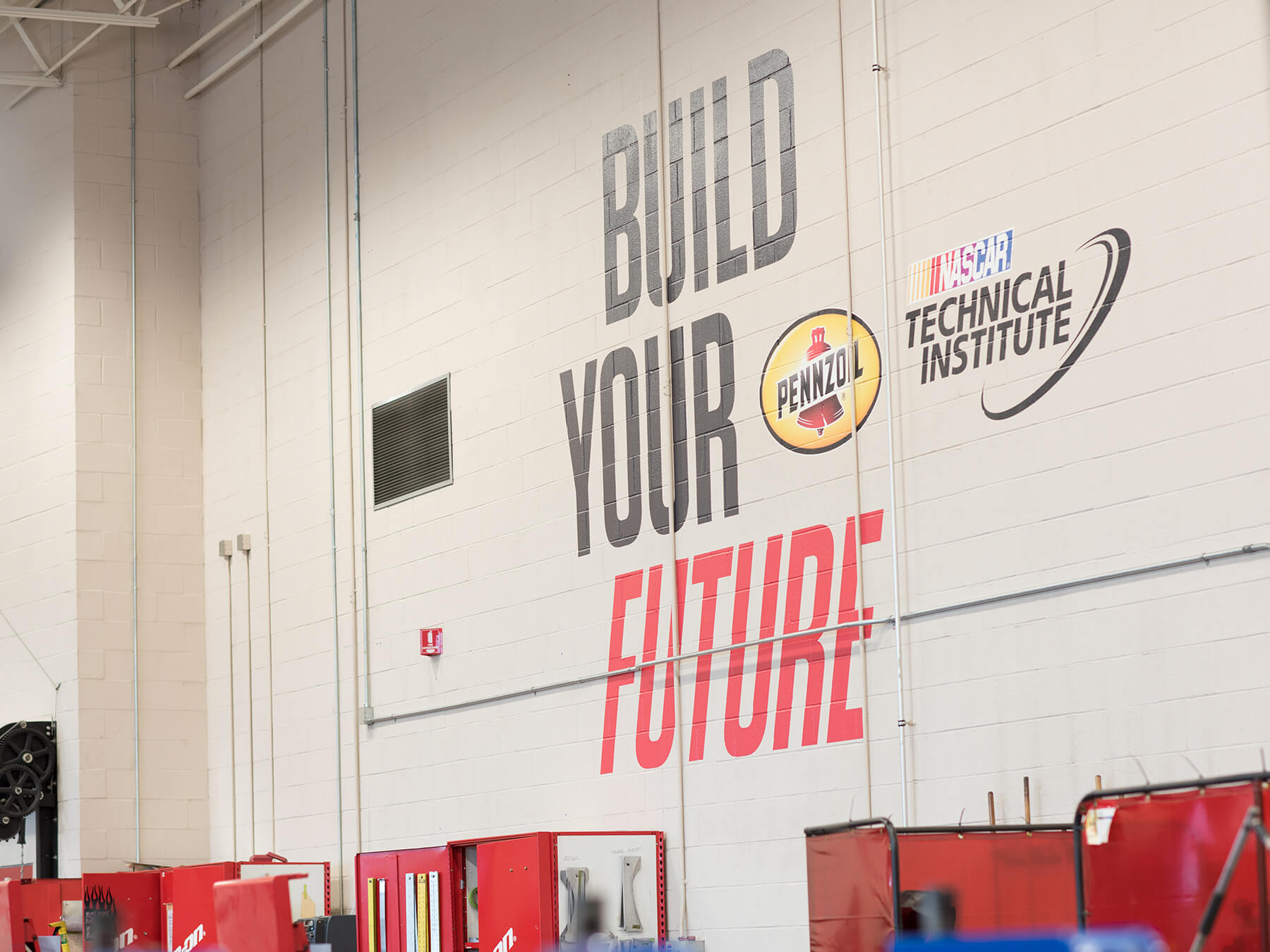 Photo of the BUILD YOUR FUTURE messaging on the side of a wall at Mooresville campus