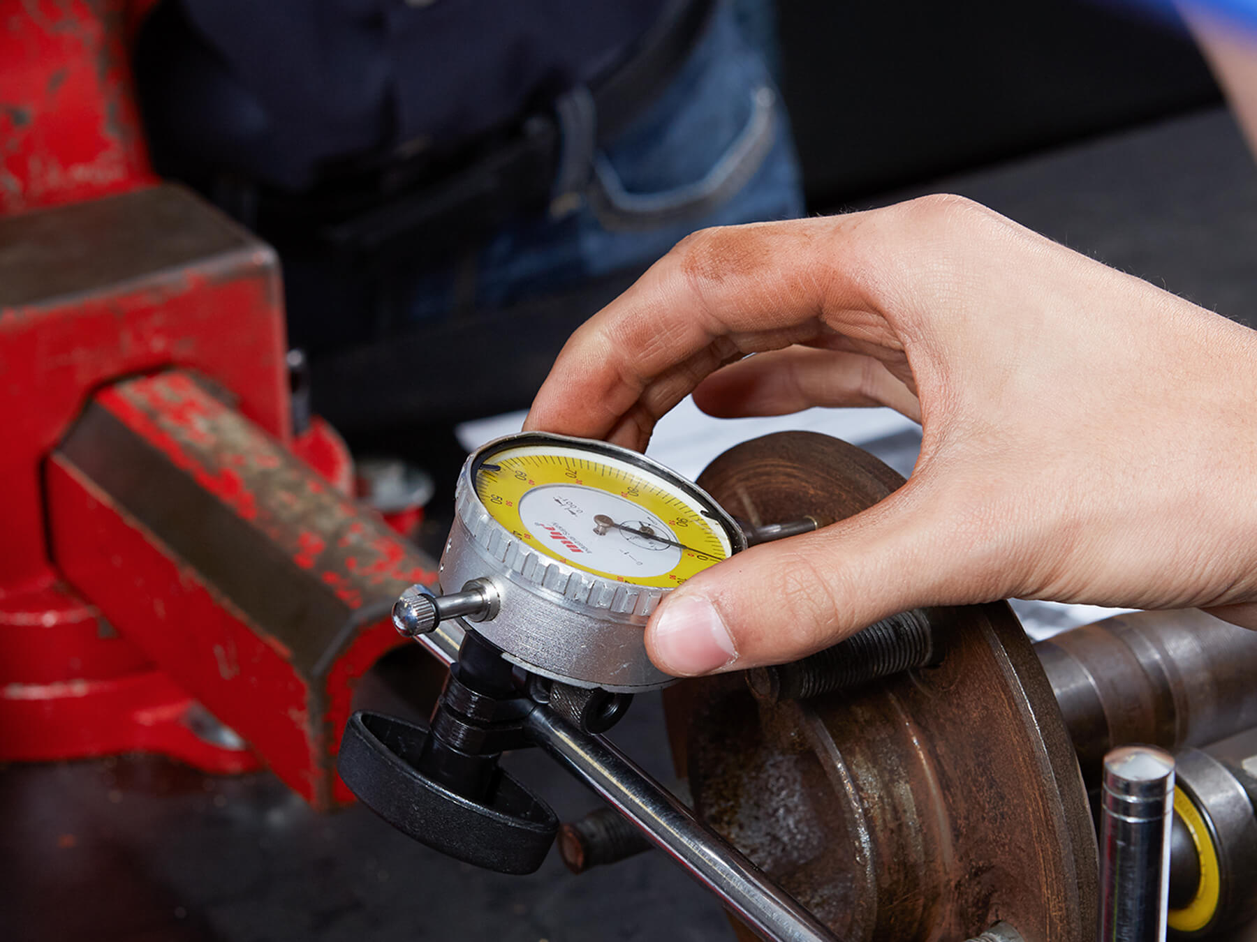 close-up on student hands working with a pressure gauge at the Dallas campus
