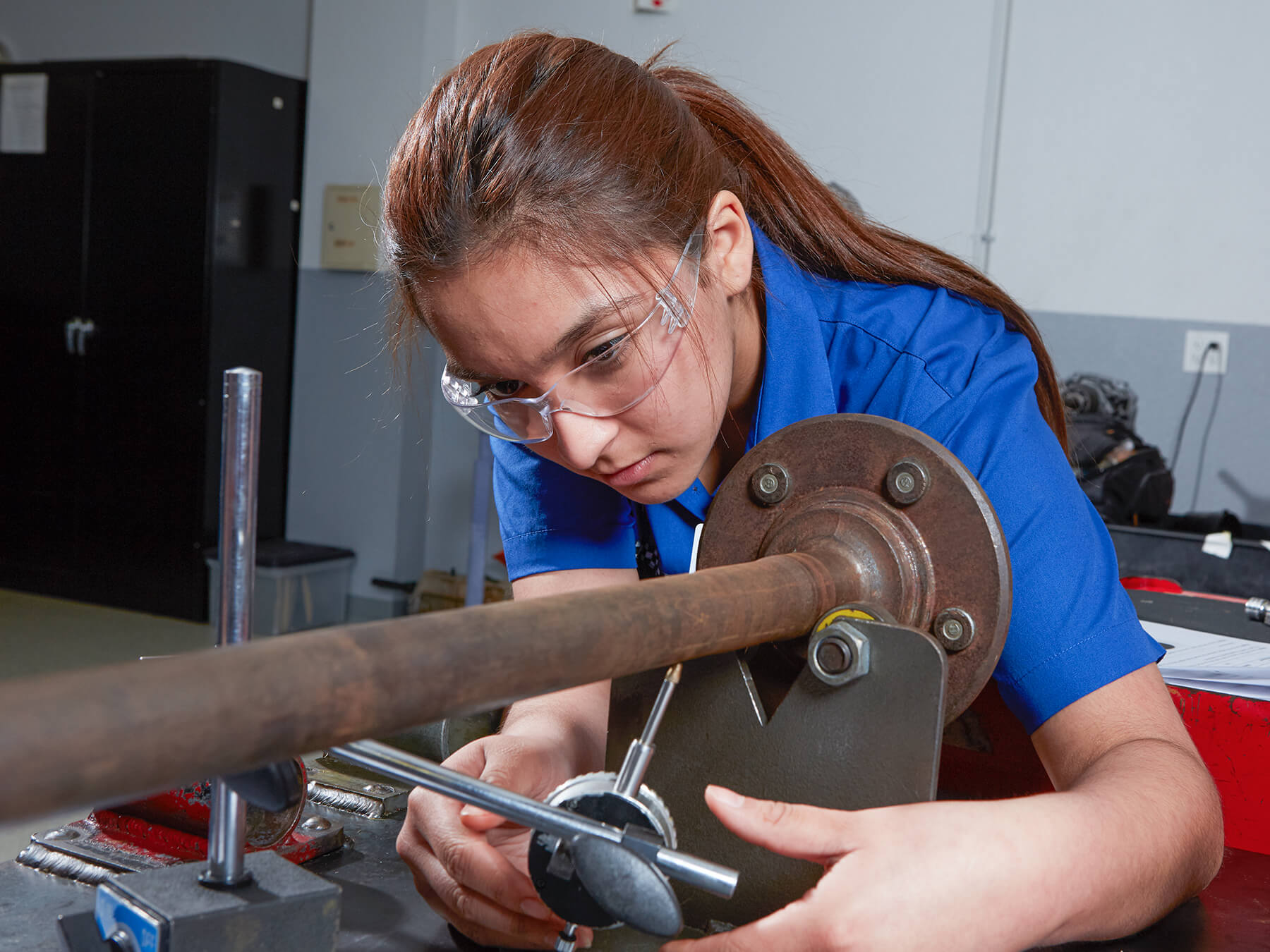 Female student working in the Power steering class at the Dallas campus