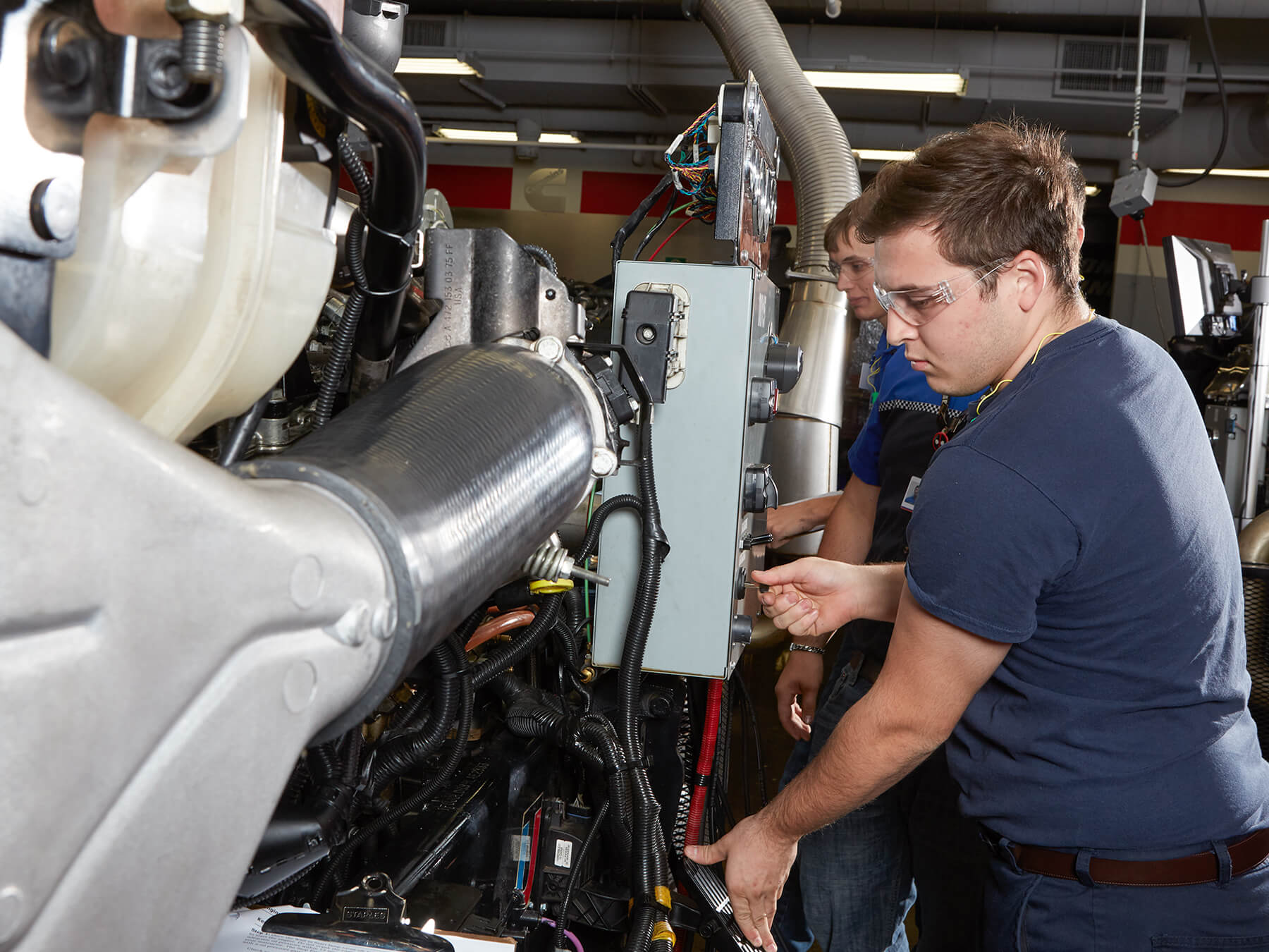 Students working a Diesel engine at the Dallas campus