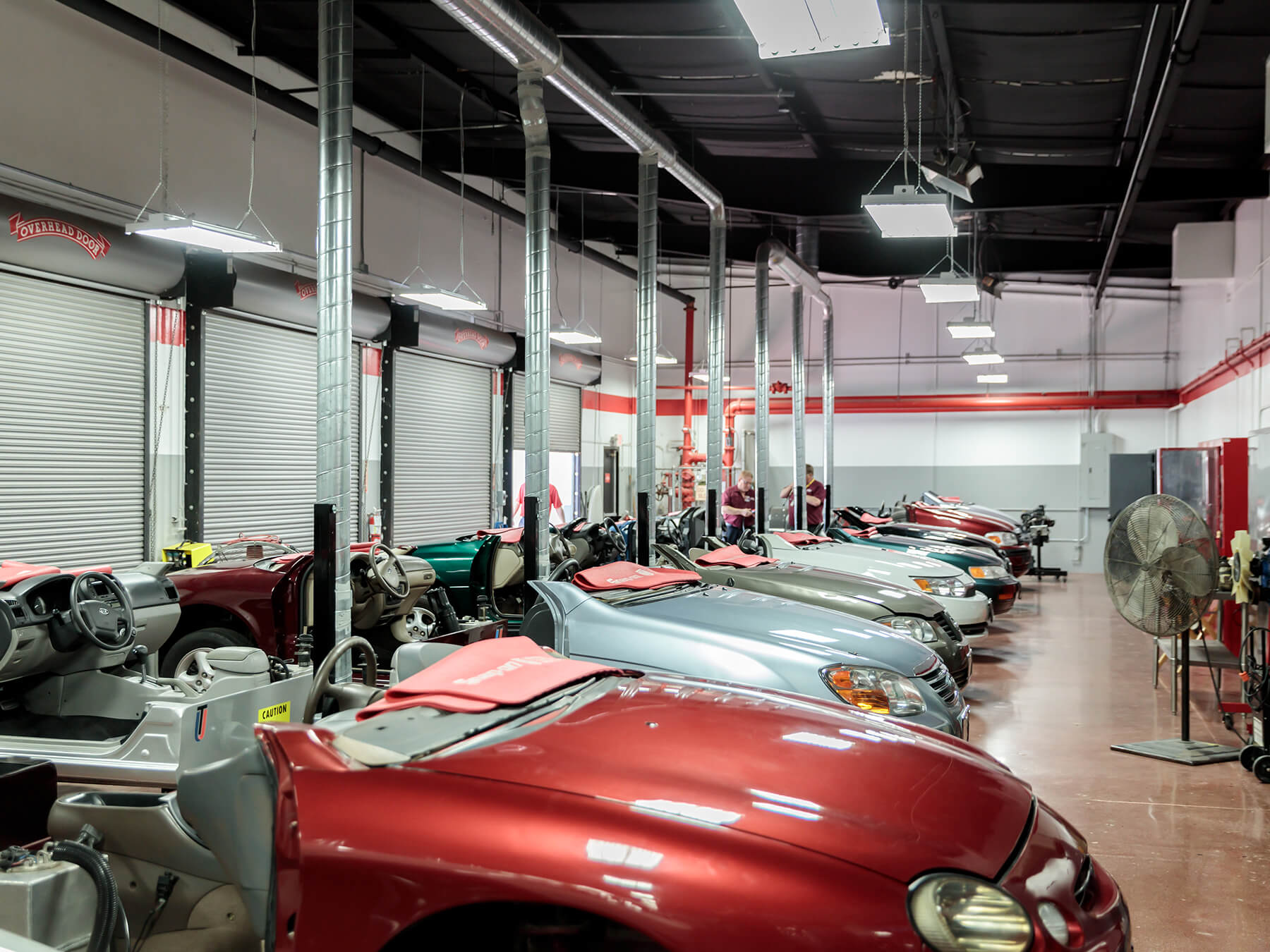 Wide angle photo of clip cars in the auto lab at the Houston campus