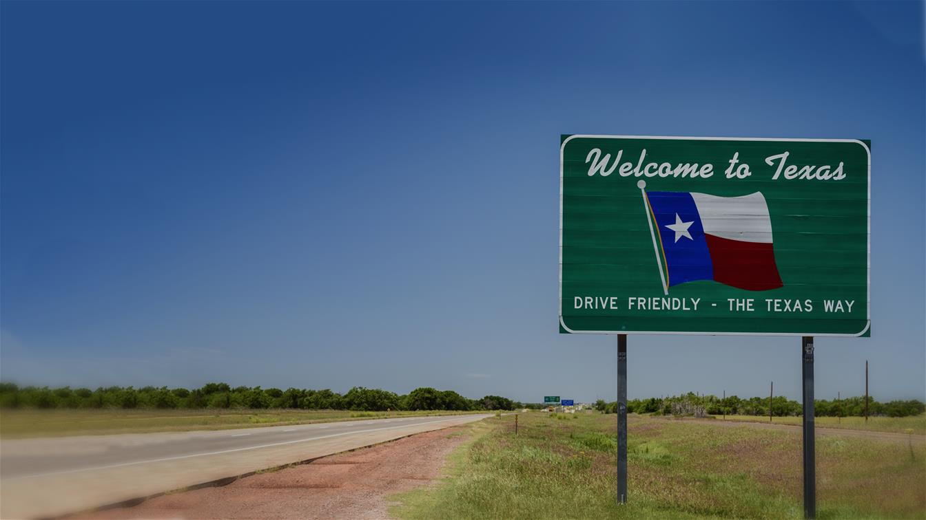 Welcome to Texas sign on highway state line