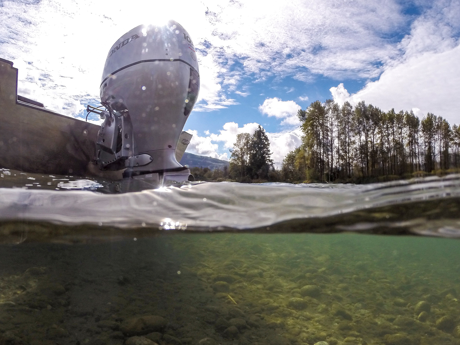Underwater photo honda engine attached to back of small boat