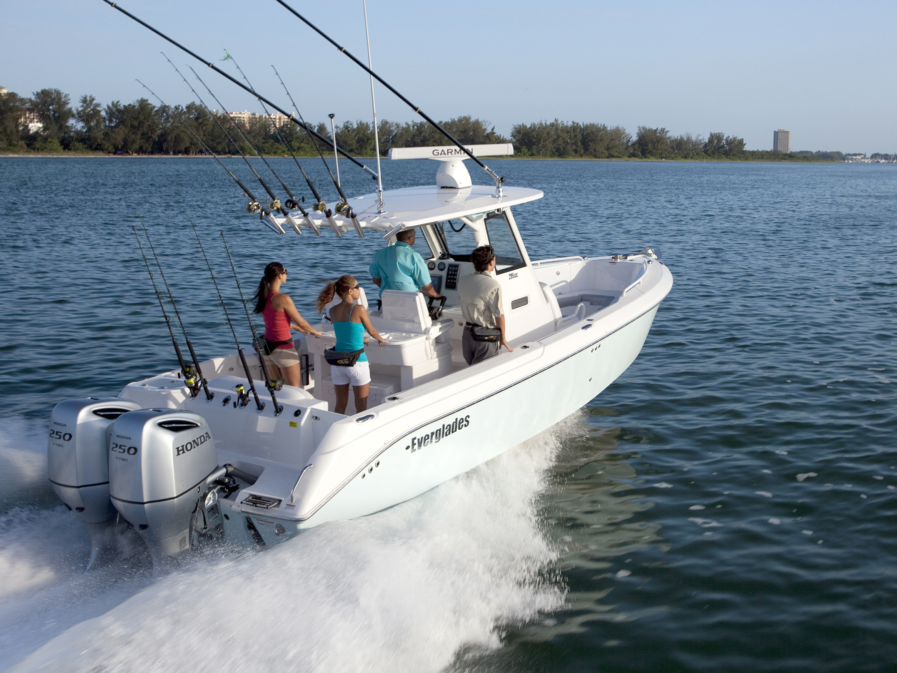 Action shot of white boat with 4 passengers in the water