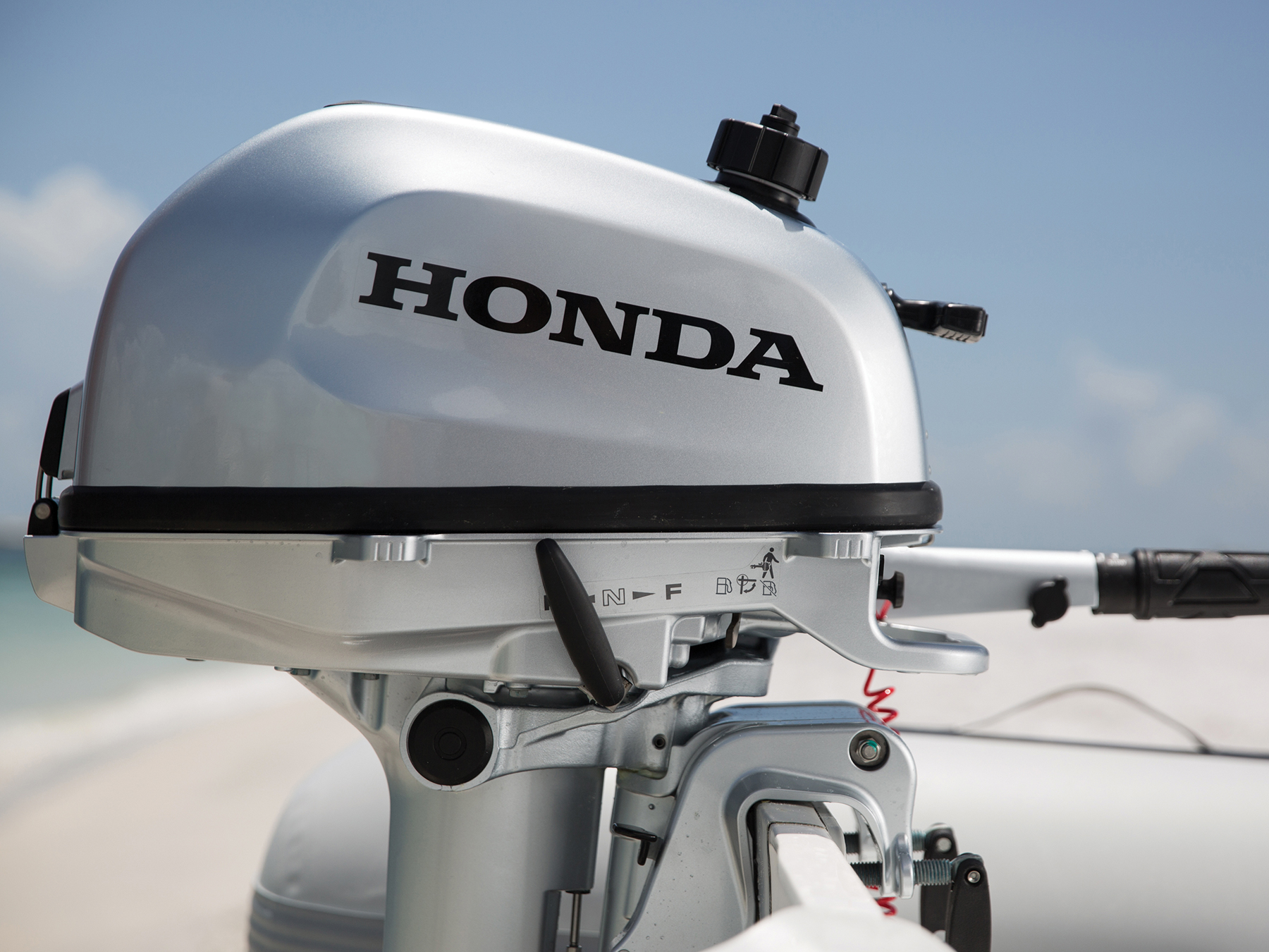 Side view of a Honda engine in the water