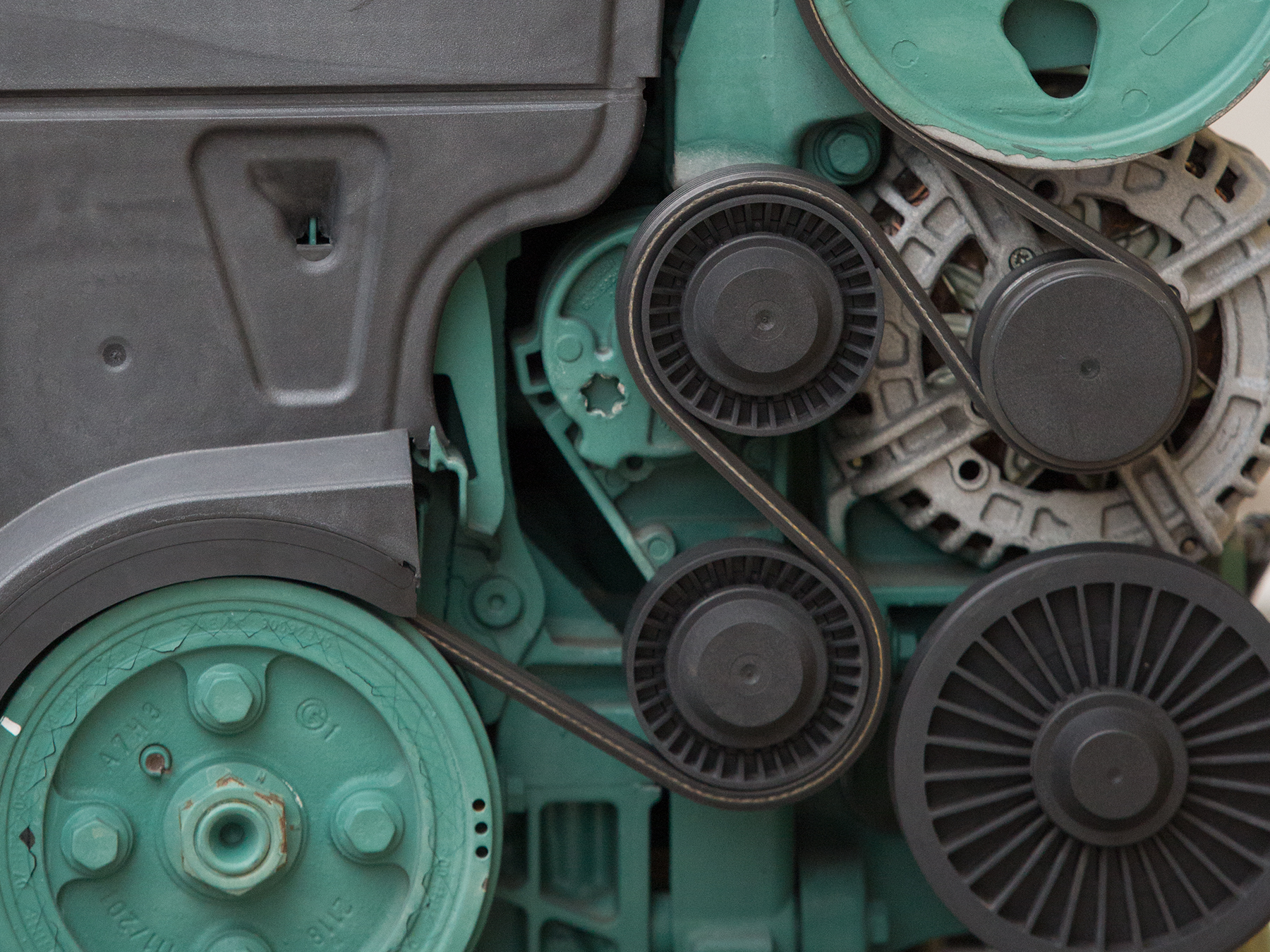 Close-up on a green and grey marine engine