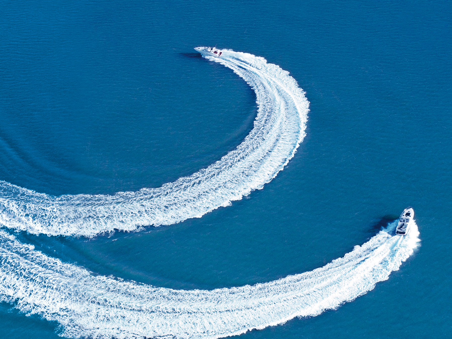 Overhead photo of Volvo Penta boats circling around in the water